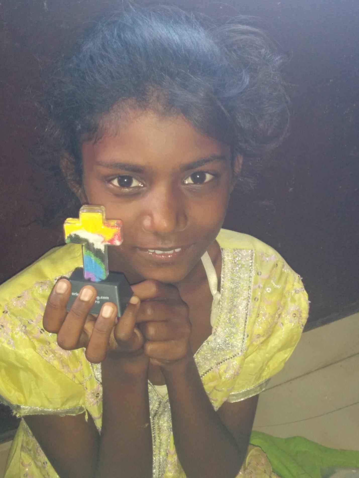 Meena with Cross